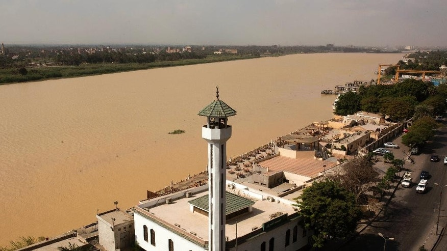 The water of the Nile River appears murky brown in color due to the flooding in southern provinces, Beni Suef and Sohag south of the capital, in Cairo, Egypt, Tuesday, Nov. 1, 2016. (AP Photo/Amr Nabil)