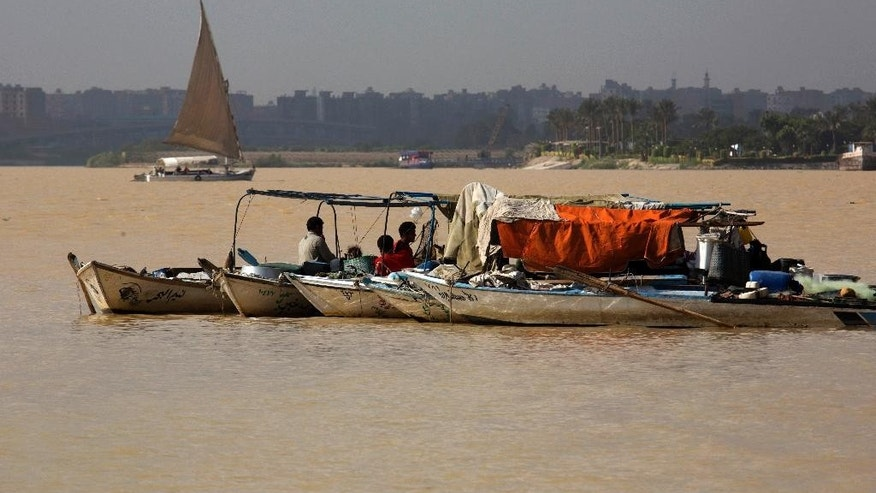 Egyptian fishermen park their boats on the Nile River, with the water appearing a murky brown color due to the flooding in southern provinces, Beni Suef and Sohag south of the capital, in Cairo, Egypt, Tuesday, Nov. 1, 2016. (AP Photo/Amr Nabil)
