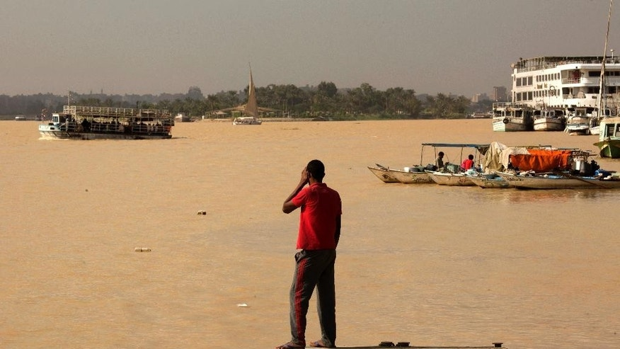 An Egyptian fisherman stands watching the Nile River as water appears a murky brown color due to the flooding in southern provinces, Beni Suef and Sohag south of the capital, in Cairo, Egypt, Tuesday, Nov. 1, 2016. (AP Photo/Amr Nabil)