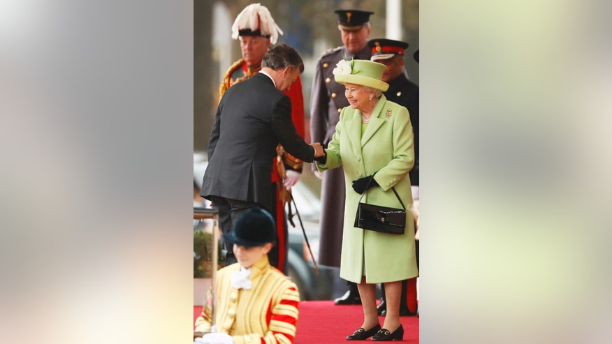 Britain's Queen Elizabeth II greets Colombia's President Juan Manuel Santos, during a ceremonial welcome for Colombia's president and his wife, Maria Clemencia Rodriguez, at Horse Guards Parade in central London, Tuesday Nov. 1, 2016.  The President of Colombia Juan Manuel Santos, this year's Nobel Peace Prize laureate is on a three day state visit to Britain. (Stefan Wermuth/Pool via AP)
