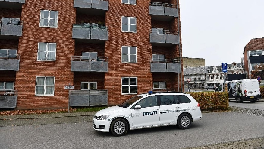 Police vehicles outside an apartment building in Aabenraa, Denmark, Monday Oct. 31, 2016, where Danish police say the remains of a 27-year-old Syrian woman and her two daughters, aged 7 and 9, were found in a freezer inside their apartment. Police made the gruesome discovery Sunday in the town of Aabenraa after a relative of the woman told them he hadn't been able to reach her for a few days. (Claus Bonnerup/AP via Polfoto)  DENMARK OUT