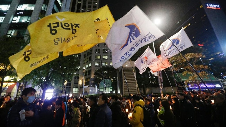 "South Korean protesters march after a rally calling for President Park Geun-hye to step down in downtown Seoul, South Korea, Tuesday, Nov. 1, 2016. South Korean police detained a man who rammed a large excavator into a gate Tuesday near the office where prosecutors questioned a woman at the center of a scandal that threatens the country's president. The woman had earlier said she ""deserves death"" and the detained man said he ""came here to help her die."" (AP Photo/Ahn Young-joon)"