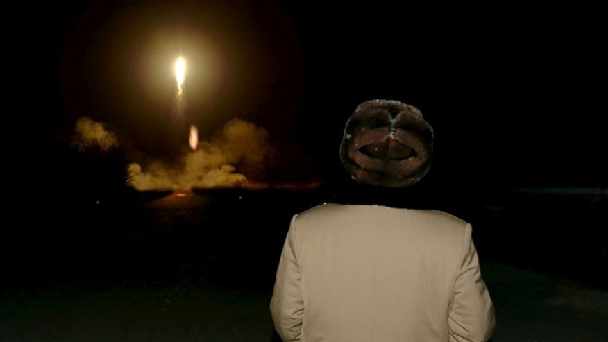 FILE: North Korean leader Kim Jong Un watches a ballistic rocket launch drill at an unknown location. The photo was released by North Korea's Korean Central News Agency on March 11.