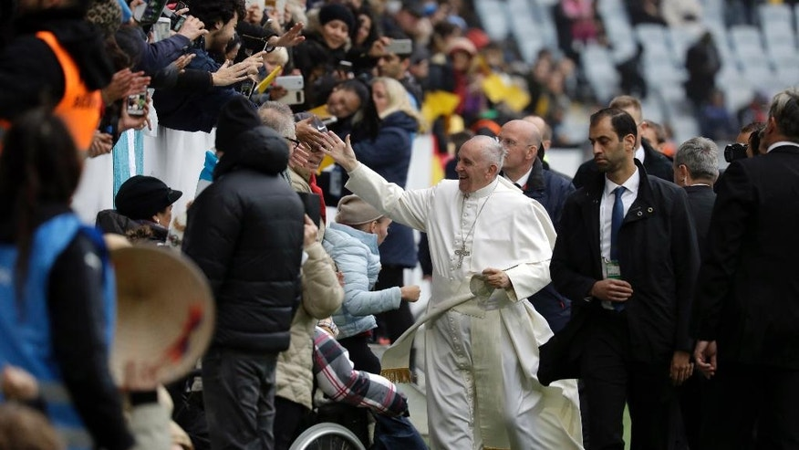 "Pope Francis greets faithful upon his arrival at the Malmo stadium, Sweden, Tuesday, Nov. 1, 2016. Francis traveled to secular Sweden on Monday to mark the 500th anniversary of the Protestant Reformation, a remarkably bold gesture given his very own Jesuit religious order was founded to defend the faith against Martin Luther's ""heretical"" reforms five centuries ago. (AP Photo/Andrew Medichini)"