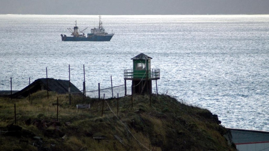 FILE - In this November 2005 file photo, a Russian border guards' tower is seen on Kunashir Island, one of the disputed Kuril Islands that are claimed by both Japan and Russia. The speaker of the Russian parliament's upper chamber said on Tuesday, Nov. 1, 2016, that Moscow isn't going to give up any of the disputed islands to Japan. (AP Photo, File)