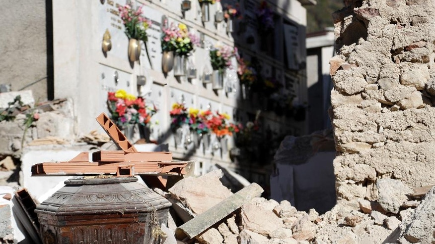 A view of the destroyed graveyard of Campi, central Italy, Monday, Oct. 31, 2016. The third powerful earthquake to hit Italy in two months spared human life Sunday but struck at the nation's identity, destroying a Benedictine cathedral, a medieval tower and other beloved landmarks that had survived the earlier jolts across a mountainous region of small historic towns. (AP Photo/Gregorio Borgia)