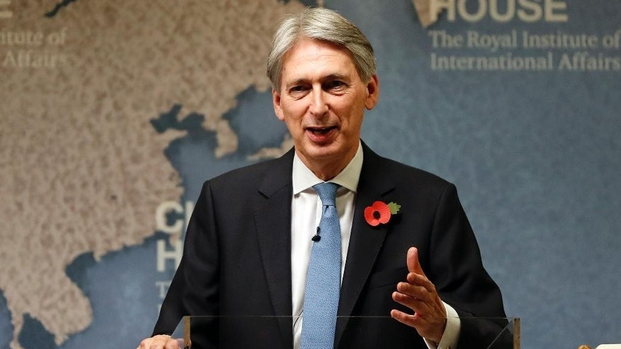 FILE - This is a Monday, Oct. 31, 2016  file photo of Britain's Chancellor of the Exchequer Philip Hammond speaks at The Royal Institute of International Affairs in London. Britain's Treasury chief Philip Hammond has promised the country will 'strike back' against cyberattacks amid fears that online threats from state-sponsored hackers jeopardize society. (AP Photo/Kirsty Wigglesworth, File)