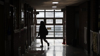 ANSAN, SOUTH KOREA - APRIL 10:  A student visits her friends classroom at the Danwon High School on April 10, 2015 in Ansan, South Korea. 325 second-year students and 15 teachers of Danwon High School on a school trip were among the 476 passengers on board the ferry that capsized off of Jindo Island in South Korea on April 16, 2014. Only 172 of the ferry's 476 passengers and crew were rescued, and out of the 304 dead or missing, 250 were school children.  (Photo by Chung Sung-Jun/Getty Images)