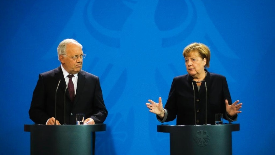 German Chancellor Angela Merkel, right, and Swiss President Johann Schneider-Ammann brief the media after a meeting at the chancellery in Berlin, Wednesday, Nov. 2, 2016. (AP Photo/Markus Schreiber).