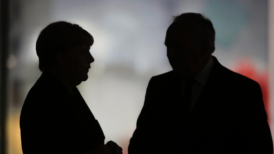 German Chancellor Angela Merkel, left, talks to Swiss President Johann Schneider-Ammann during a meeting at the chancellery in Berlin, Wednesday, Nov. 2, 2016. (AP Photo/Markus Schreiber).