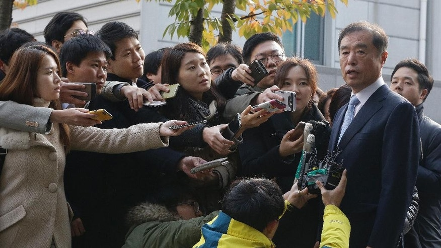 Newly appointed Prime Minister Kim Byong-joon, right, speaks to the media as he arrives at his office in Seoul, South Korea, Thursday, Nov. 3, 2016. South Korea's embattled President Park Geun-hye replaced her prime minister and two other top officials on Wednesday in a bid to restore public confidence amid a political scandal involving her longtime friend. (AP Photo/Ahn Young-joon)