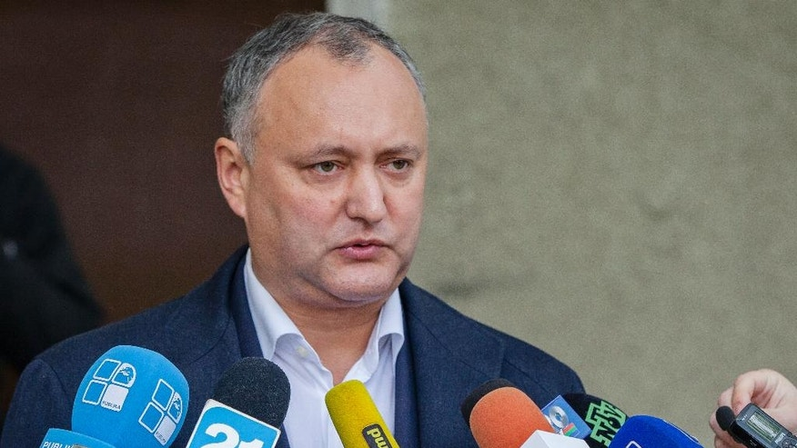 The leader of Socialists Party Igor Dodon speaks to media after casting his vote during the presidential elections in Chisinau, Moldova, Sunday, Oct. 30, 2016. Moldovans began voting Sunday for a president in an election that could move the former Soviet republic closer to Europe or push it back into Russia's orbit.(AP Photo/Roveliu Buga)
