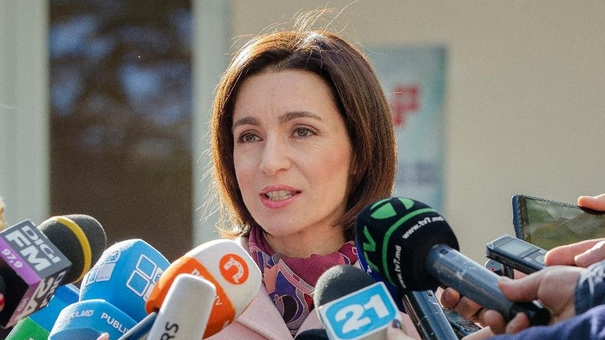 The leader of the Action and Solidarity Party, Maia Sandu, speaks to media after casting her vote during the presidential elections in Chisinau, Moldova, Sunday, Oct. 30, 2016. Moldovans began voting Sunday for a president in an election that could move the former Soviet republic closer to Europe or push it back into Russia's orbit.(AP Photo/Roveliu Buga)