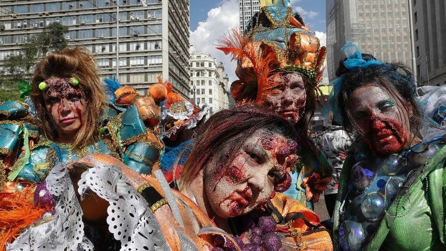 People in zombie costumes take part in the Zombie Walk in Sao Paulo, Brazil, Wednesday, Nov. 2, 2016. Participants commemorated the Day of the Dead with the annual Zombie Walk. (AP Photo/Andre Penner)