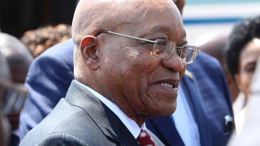 South African President Jacob Zuma is seen upon arrival in Harare, Zimbabwe, Thursday, Nov, 3, 2016. Zuma has travelled to neighboring Zimbabwe on state business following the release of a state watchdog report indicating possible South African government corruption linked to him and his associates. (AP Photo/Tsvangirayi Mukwazhi)