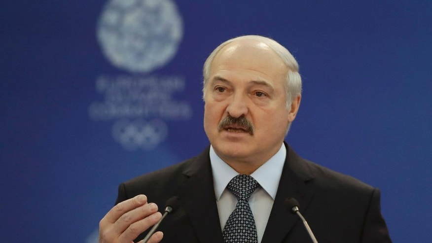 FILE In this Friday, Oct. 21, 2016 file photo Belarus' President Alexander Lukashenko gestures while speaking at the European Olympic Committees General Assembly in Minsk, Belarus. Mired in a multi-year recession and bitter loan talks with the International Monetary Fund, it would appear a strange time for Belarus to take on the burden of hosting a major sports event, the 2019 European Games. (AP Photo/Sergei Grits, File)