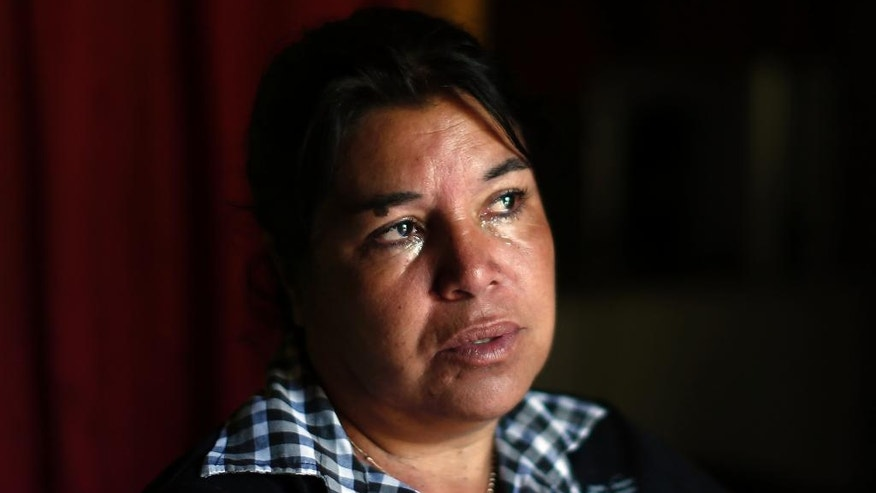"In this 22 Oct. 2016 photo, Juana Poblete cries as she talks about her daughter, Lissette, who died under the care of the Chilean state, in Til Til, Chile. The former head of the National Service for Minors later said that Lisette died because she was ""conflictive."" But a police investigation has shown that the child's caretakers were partly responsible for her death and failed to administer the CPR that could have saved her life. (AP Photo/Luis Hidalgo)."
