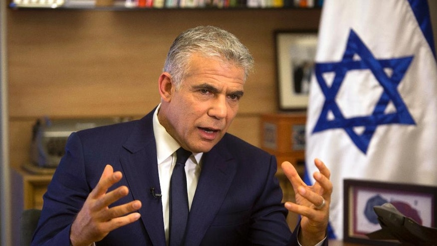 In this Monday, Oct. 31, 2016 photo, Israeli Knesset member, Yair Lapid, leader of the Yesh Atid party, speaks during an interview with The Associated Press, in his office at the Knesset, Israel's parliament, in Jerusalem. Lapid believes he has finally found a formula that will allow him to do something that has eluded Israeli politicians for nearly a decade: Defeat Prime Minister Benjamin Netanyahu in an election. Just three years after Lapid gave up a successful media career for the rough-and-tumble of Israeli politics, his centrist Yesh Atid party has been surging in opinion polls -- repeatedly coming out ahead of Netanyahu's long-dominant Likud Party. (AP Photo/Sebastian Scheiner)