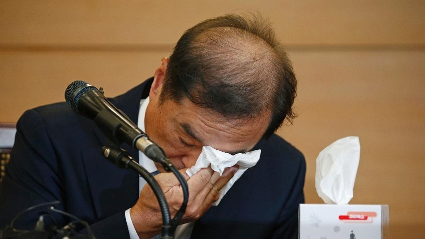 Kim Byong-joon, newly nominated for South Korea's prime minister, wipes his eyes after a news conference Thursday, Nov. 3, 2016, in Seoul, South Korea. South Korea's President Park Geun-hye's office said Wednesday that Park nominated Kim Byong-joon, a former top policy adviser for late liberal President Roh Moo-hyun, as her new prime minister. Kim's selection is subject to parliamentary approval. (Kim Hong-Ji, Pool via AP)