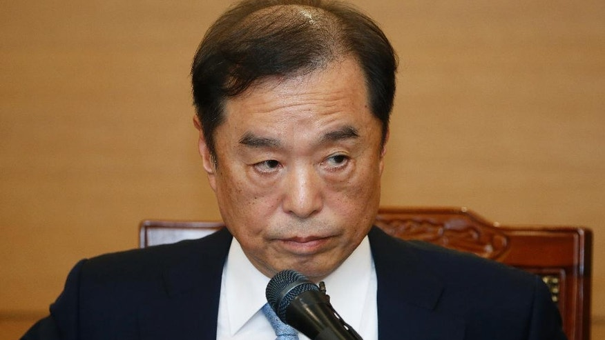 Kim Byong-joon, a nominee for South Korea's Prime Minister, speaks during a news conference Thursday, Nov.  3, 2016, in Seoul, South Korea. South Korea's President Park Geun-hye's office said Wednesday that Park nominated Kim, a former top policy adviser for late liberal President Roh Moo-hyun, as her new prime minister. Kim's selection is subject to parliamentary approval. (Kim Hong-Ji, Pool via AP)