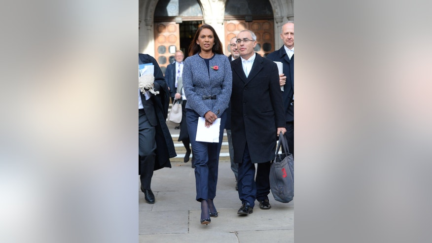 Business woman Gina Miller leaves the High Court in London, Thursday Nov. 3, 2016. In a major blow for Britain's government, the High Court ruled Thursday that the prime minister can't trigger the U.K.'s exit from the European Union without approval from Parliament. The government is likely to appeal the ruling to the Supreme Court.  (Dominic Lipinski/PA via AP)