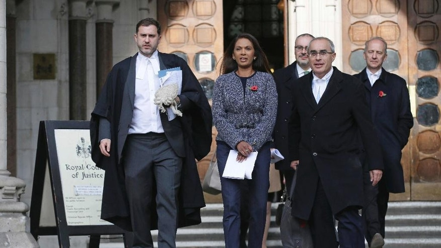 Financial entrepreneur Gina Miller, one of the claimants who challenged plans for Brexit, leaves the High Court in London, Thursday Nov. 3, 2016. In a major blow for Britain's government, the High Court ruled Thursday that the prime minister can't trigger the U.K.'s exit from the European Union without approval from Parliament. (AP Photo/Tim Ireland)