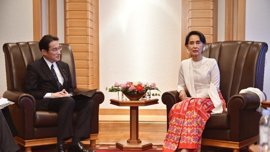 Myanmar Foreign Minister Aung San Suu Kyi, right,  talks with Japan's Foreign Minister Fumio Kishida, left,  during their talks at a hotel in Tokyo Thursday, Nov. 3, 2016.  During her five-day visit, Suu Kyi is to meet with Japanese business leaders to seek investment. She also will travel to Kyoto to be awarded an honorary doctorate from Kyoto University, where she was a visiting scholar for one year. (Kazuhiro Nogi/Pool Photo via AP)