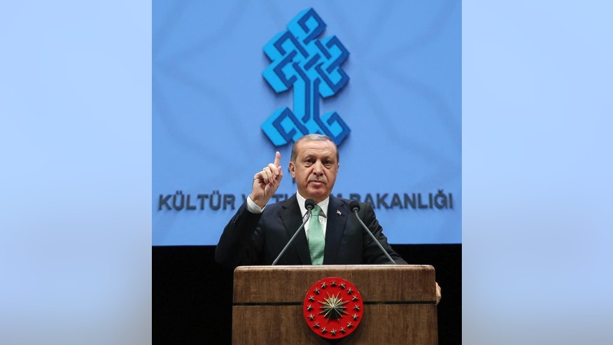 Turkey's President Recep Tayyip Erdogan addresses a meeting at his palace in Ankara, Turkey, Thursday, Nov. 3, 2016. Erdogan has harshly criticized Germany, accusing it of supporting terrorism and slamming comments suggesting Berlin may not extradite suspects wanted by Turkey if it considers the case is politically motivated.(Murat Cetinmuhurdar/Pool photo via AP)