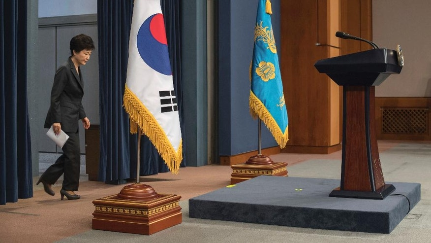 "South Korean President Park Geun-hye bows arrives to address the nation at the presidential Blue House in Seoul Friday, Nov. 4, 2016. Park took sole blame Friday for a ""heartbreaking"" scandal that threatens her government and vowed she will accept a direct investigation into her actions amid rising suspicion that she allowed a mysterious confidante to manipulate power from the shadows. (Ed Jones/Pool Photo via AP)"