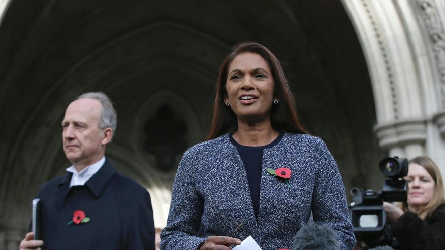 Financial entrepreneur Gina Miller, one of the claimants who challenged plans for Brexit, arrives to speak to the media outside the High Court in London, Thursday Nov. 3, 2016. In a major blow for Britain's government, the High Court ruled Thursday that the prime minister can't trigger the U.K.'s exit from the European Union without approval from Parliament. (AP Photo/Tim Ireland)