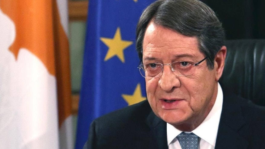Cyprus President Nicos Anastasiades speaks during a nationally televised news conference at the Presidential Palace in Nicosia, Cyprus, Friday, Nov. 4, 2016. The president of ethnically divided Cyprus says Turkey's input will be pivotal in overcoming key obstacles preventing a reunification deal. Nicos Anastasiades, a Greek Cypriot, says he and breakaway Turkish Cypriot leader Mustafa Akinci have made significant progress on numerous issues making an envisioned federation workable. (Yiannis Kourtoglou, Pool Photo via AP)
