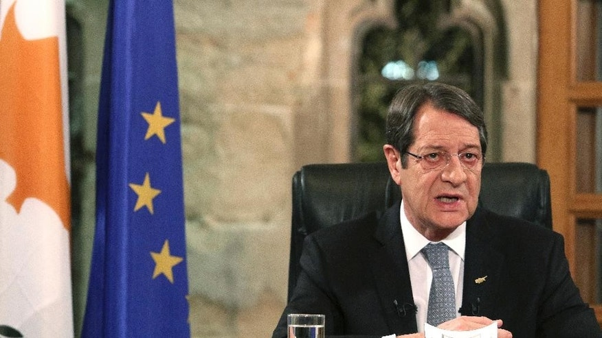 Cyprus President Nicos Anastasiades speaks during a nationally televised news conference at the Presidential Palace in Nicosia, Cyprus, Friday, Nov. 4, 2016. The president of ethnically divided Cyprus says Turkey's input will be pivotal in overcoming key obstacles preventing a reunification deal. Nicos Anastasiades, a Greek Cypriot, says he and breakaway Turkish Cypriot leader Mustafa Akinci have made significant progress on numerous issues making an envisioned federation workable. (Yiannis Kourtoglou/Pool Photo via AP)