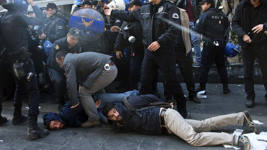 Police officers detain supporters of pro-Kurdish Peoples' Democratic Party, HDP, as they protest the detentions of Kurdish lawmakers, in Ankara, Turkey, Friday, Nov. 4, 2016. Authorities in Turkey detained 11 pro-Kurdish lawmakers early Friday as part of ongoing terror-related investigations, including both party co-chairs Selahattin Demirtas and Figen Yuksekdag and other senior officials, the Interior Ministry said. (AP Photo)