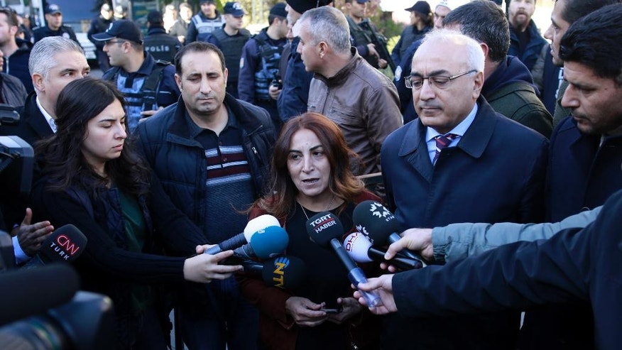 Aysel Tugluk, a pro-Kurdish politician, speaks to the media during a protest against the detention of pro-Kurdish Peoples' Democratic Party, or HDP, lawmakers, in Ankara, Turkey, Friday, Nov. 4, 2016. Authorities in Turkey detained 11 pro-Kurdish lawmakers early Friday as part of ongoing terror-related investigations, including both party co-chairs Selahattin Demirtas and Figen Yuksekdag and other senior officials, the Interior Ministry said. (AP Photo)