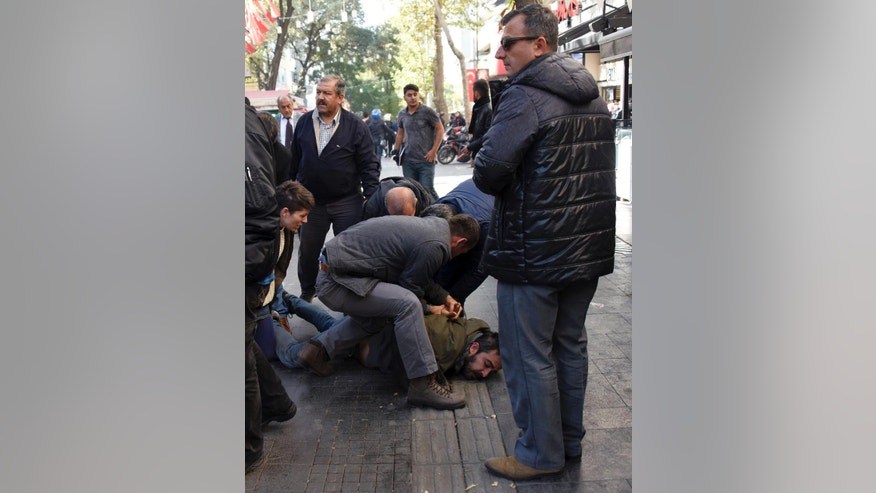 Police officers detain supporters of pro-Kurdish Peoples' Democratic Party, HDP, as they protest against the detentions of Kurdish lawmakers, in Ankara, Turkey, Friday, Nov. 4, 2016. Authorities in Turkey detained 11 pro-Kurdish lawmakers early Friday as part of ongoing terror-related investigations, including both party co-chairs Selahattin Demirtas and Figen Yuksekdag and other senior officials, the Interior Ministry said. (AP Photo)