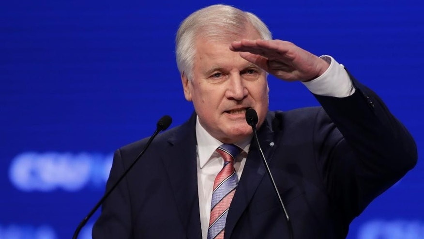 Bavarian State Governor and Chairman of German Christian Social Union party, CSU, Horst Seehofer, gestures during his speech at a party convention of the German Christian Social Union, CSU, in Munich, Germany, Friday, Nov. 4, 2016. (AP Photo/Matthias Schrader)