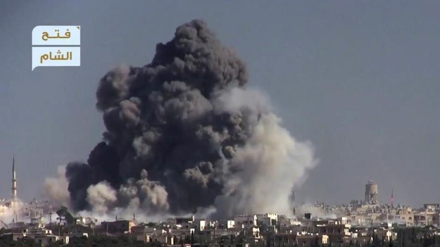 This frame grab from video provided by this militant video by Fatah al-Sham Front that is consistent with independent AP reporting, shows black smoke rises from a suicide bomb attacked Syrian government forces positions, in western Aleppo, Syria, Thursday, Nov. 3, 2016. The Britain-based Syrian Observatory for Human Rights, which monitors the conflict through local contacts, reported that rebels attacked government positions with two explosives-laden vehicles. Syrian rebels launched a fresh wave of attacks on western districts of Aleppo Thursday as airstrikes on a rebel-held village south of the contested city killed civilians, activists said. (militant video by Fatah al-Sham Front, via AP)