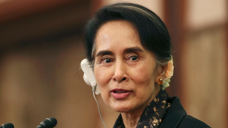 Myanmar's Foreign Minister Aung San Suu Kyi speaks during a press conference at the conclusion of her visit to Japan, in Tokyo, Friday, Nov. 4, 2016. Suu Kyi said her government will not blame anyone in recent violence in the Rakhine state until the authorities have all the evidence. Her comment Friday comes amid growing concerns among international rights groups over a surge in violence by security forces in Rakhine, home to many Rohingya minorities, since Oct. 9. (AP Photo/Koji Sasahara)