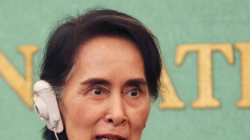 Myanmar's Foreign Minister Aung San Suu Kyi speaks during a press conference in Tokyo, Friday, Nov. 4, 2016. Suu Kyi said her government will not blame anyone in recent violence in the Rakhine state until the authorities have all the evidence. Her comment Friday comes amid growing concerns among international rights groups over a surge in violence by security forces in Rakhine, home to many Rohingya minorities, since Oct. 9. (AP Photo/Koji Sasahara)