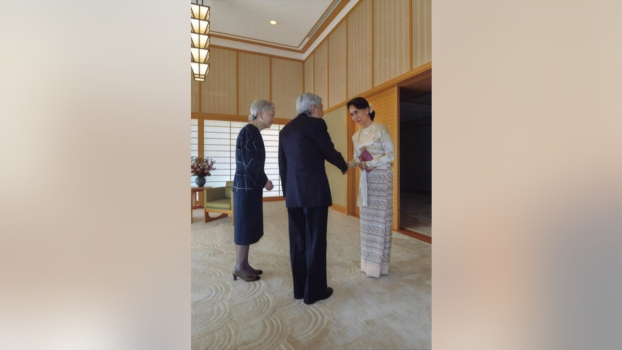 In this photo released by Imperial Household Agency of Japan, Emperor Akihito and Empress Michiko, left, meets Myanmar Foreign Minister Aung San Suu Kyi at the Imperial Palace in Tokyo Friday, Nov. 4, 2016.  (Imperial Household Agency of Japan via AP)