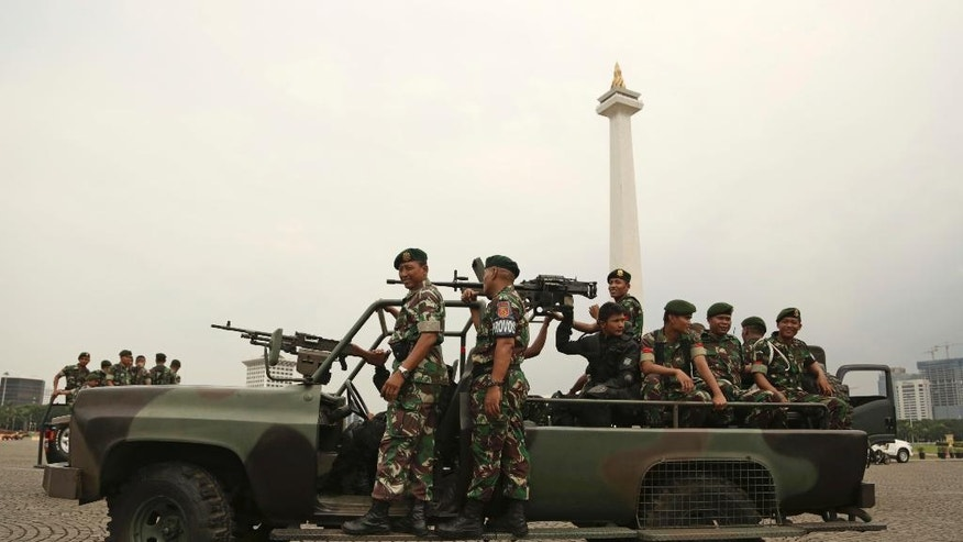 Indonesian soldiers patrol at Monas, the national monument, in Jakarta, Indonesia, Thursday, Nov. 3, 2016. Indonesian police are planning a massive show of force in the capital Jakarta on Friday to contain a much-hyped protest by Muslim hardliners against the city's popular governor that threatens to ignite the country's religious and racial flashpoints. (AP Photo/Achmad Ibrahim)