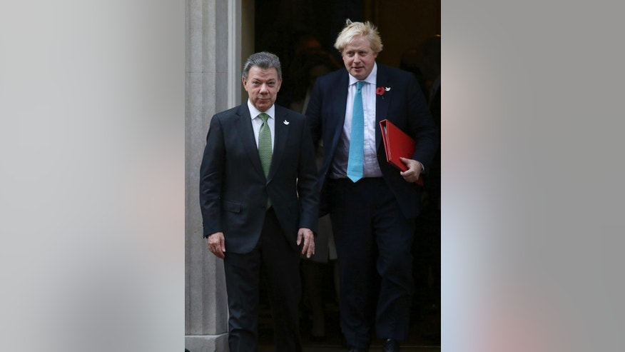 President of Colombia Juan Manuel Santos, left, and Britain's Foreign Secretary Boris Johnson leave 10 Downing Street, London, Wednesday Nov.2 2, 2016. This year's Nobel Peace Prize laureate the President of Colombia Juan Manuel Santos and his wife Maria Clemencia Rodriguez are on a three day state visit to Britain. (AP Photo/Tim Ireland)