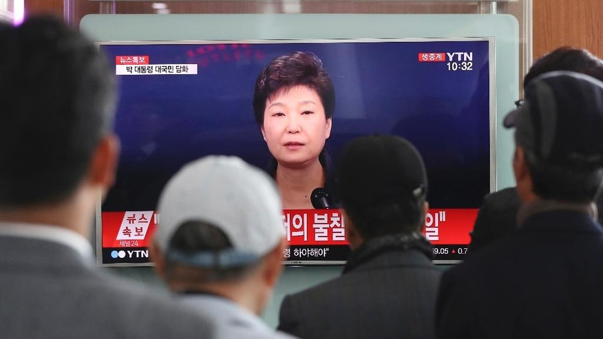 "People watch a TV screen showing the live broadcast of South Korean President Park Geun-hye's address to the nation, at the Seoul Railway Station in Seoul, South Korea, Friday, Nov. 4, 2016. Park took sole blame Friday for a ""heartbreaking"" scandal that threatens her government and vowed she will accept a direct investigation into her actions amid rising suspicion that she allowed a mysterious confidante to manipulate power from the shadows. (AP Photo/Lee Jin-man)"