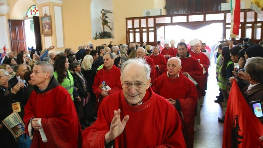 Catholic cardinals enter the cathedral in the northern city of Shkoder, Albania, which celebrated the beatification of 38 Catholic martyrs executed or tortured to death during the former communist regime Saturday, Nov. 5, 2016. Albanians celebrated their beatification after Pope Francis had officially recognized as martyrs Archbishop Vincens Prenushi and 37 other priests who died in prison or were murdered in 1945-1974 by the late communist dictator Enver Hoxha's regime. (AP Photo/Hektor Pustina)