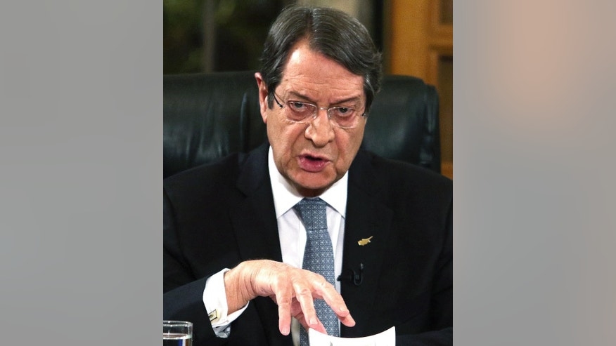 FILE - In this file photo dated Friday Nov. 4, 2016, Cyprus President Nicos Anastasiades speaks during a nationally televised news conference at the Presidential Palace in Nicosia, Cyprus.   Past efforts to solve the ethnical division of Cyprus have failed, but details are revealed Saturday Nov. 5, 2016, that leaders are heading to the Swiss resort of Mont Pelerin for meetings next week that could be the precursor to one last summit to sort out the final details of a deal.(Yiannis Kourtoglou/FILE Pool Photo via AP)