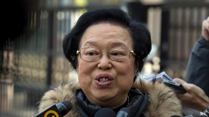 "Maria Tam, a Hong Kong deputy to the National People's Congress speaks to the media in Beijing, China, Saturday, Nov. 5, 2016.  Beijing plans to intervene in a Hong Kong political dispute over two young, newly elected separatist lawmakers in a rare move that is stoking fears the Chinese-ruled city's considerable autonomy and independent judiciary are under threat.   Tam told reporters that the NPC has the ""final say"" on the dispute and that Hong Kong's highest court would accept the NPC interpretation as binding.(AP Photo/Ng Han Guan)"