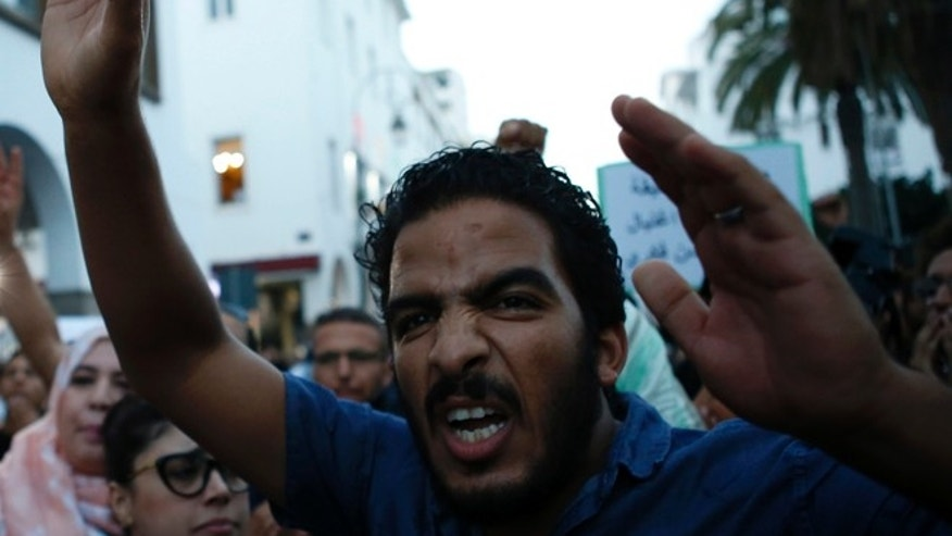 A Moroccan shouts as thousands of Moroccans protest against Fikri's death last Friday in the northern city of Hoceima in Rabat, Morocco