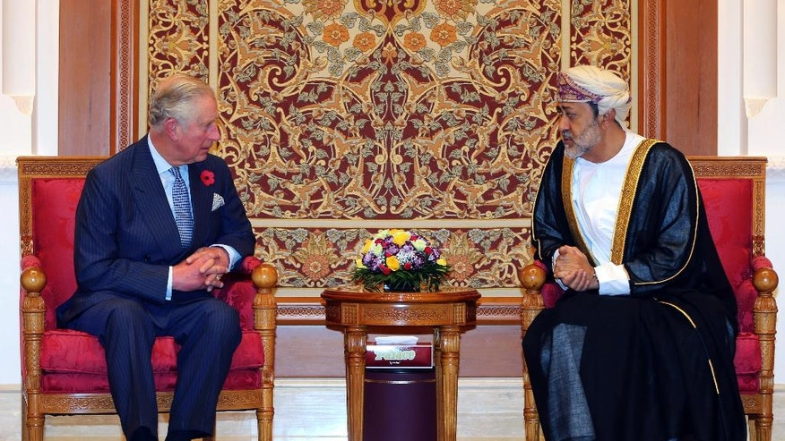 Oman's Minister of Heritage and Culture Sayyd Haithm bin Tareq, right, receives Britain's Prince Charles after his arrival with wife Camilla, Duchess of Cornwall, not pictured, for their three Gulf countries visit, in Muscat, Oman, Friday, Nov. 4, 2016. (AP Photo/Kamran Jebreili)