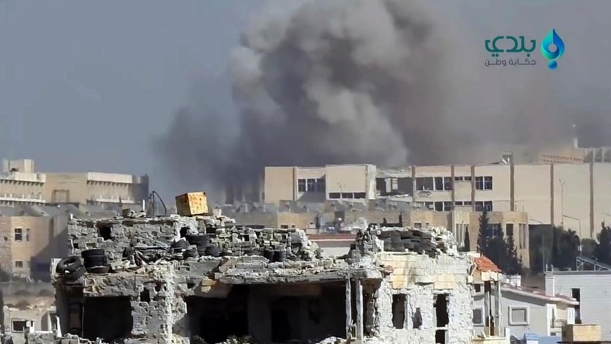 This frame grab from video provided by Baladi News Network, a Syrian opposition media outlet that is consistent with independent AP reporting, shows smoke rises from shelling on the Syrian government military academy, in western Aleppo, in southwest of Aleppo, Syria, Thursday, Nov. 3, 2016. Syrian rebels launched a fresh wave of attacks on western districts of Aleppo Thursday as airstrikes on a rebel-held village south of the contested city killed civilians, activists said. (Baladi News Network, via AP)