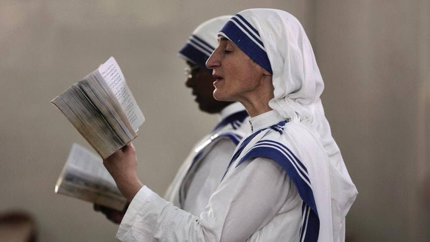 Nuns attend a Sunday mass held by Cardinal Vincent Nichols, Archbishop of Westminster, at the Holy Family Catholic Church in Gaza City, Sunday, Nov. 6, 2016. (AP Photo/ Khalil Hamra)